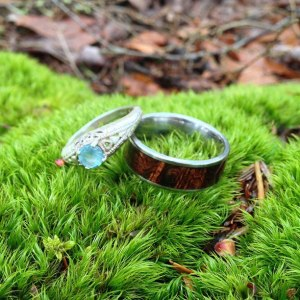 Picture of my partner's and my rings on top of moss