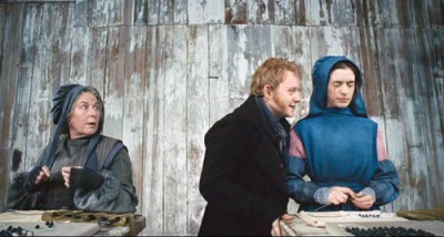 Les Mis movie image: Fantine being sexually harassed by the foreman