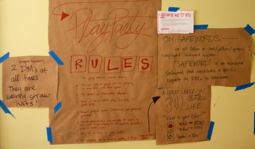 Set of brown paper signs detailing house rules and house safewords