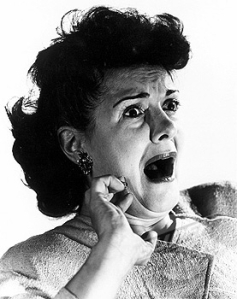 Woman gasping with terror, c 1940s.