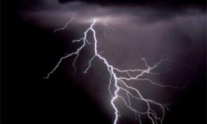 Lightning bolt striking out of a storm cloud