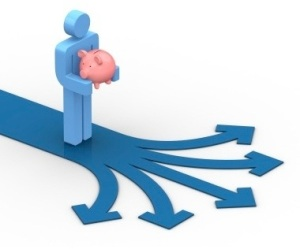 A person stands at a crossroads holding a piggybank