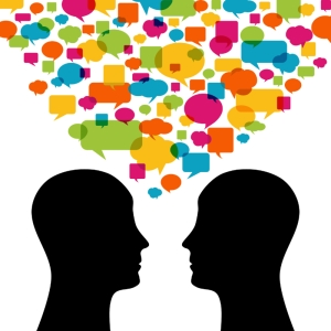 Two people talking with multi-colored speech bubbles over their heads