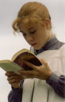 "Anne of Green Gables reading ""Anne of Green Gables."" But instead of Anne of Green Gables it will be you. And instead of ""Anne of Green Gables"" it will be our blog."