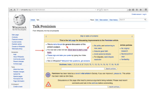 Photo of talk page of Wikipedia feminism article, with arrows pointing to the link to start a new topic for discussion.