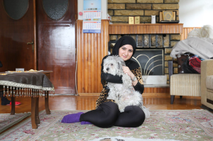 Photo of Aya, a Syrian Refugee, and her dog